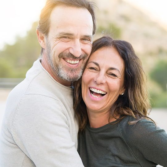 middle aged couple laughing together (edited)